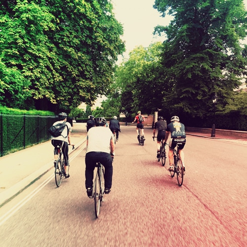 A group of YunoJuno staff ride their bikes through Regent's Park.