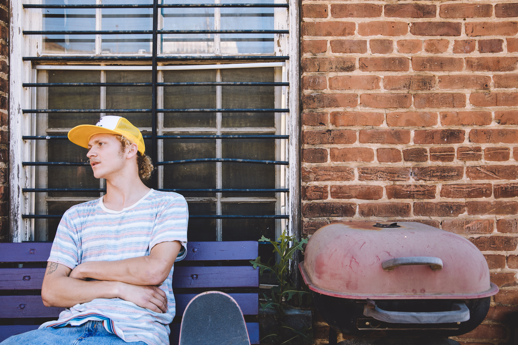 A Youth Sits With His Trusty BBQ To Represent The Millennial Idea of Safety