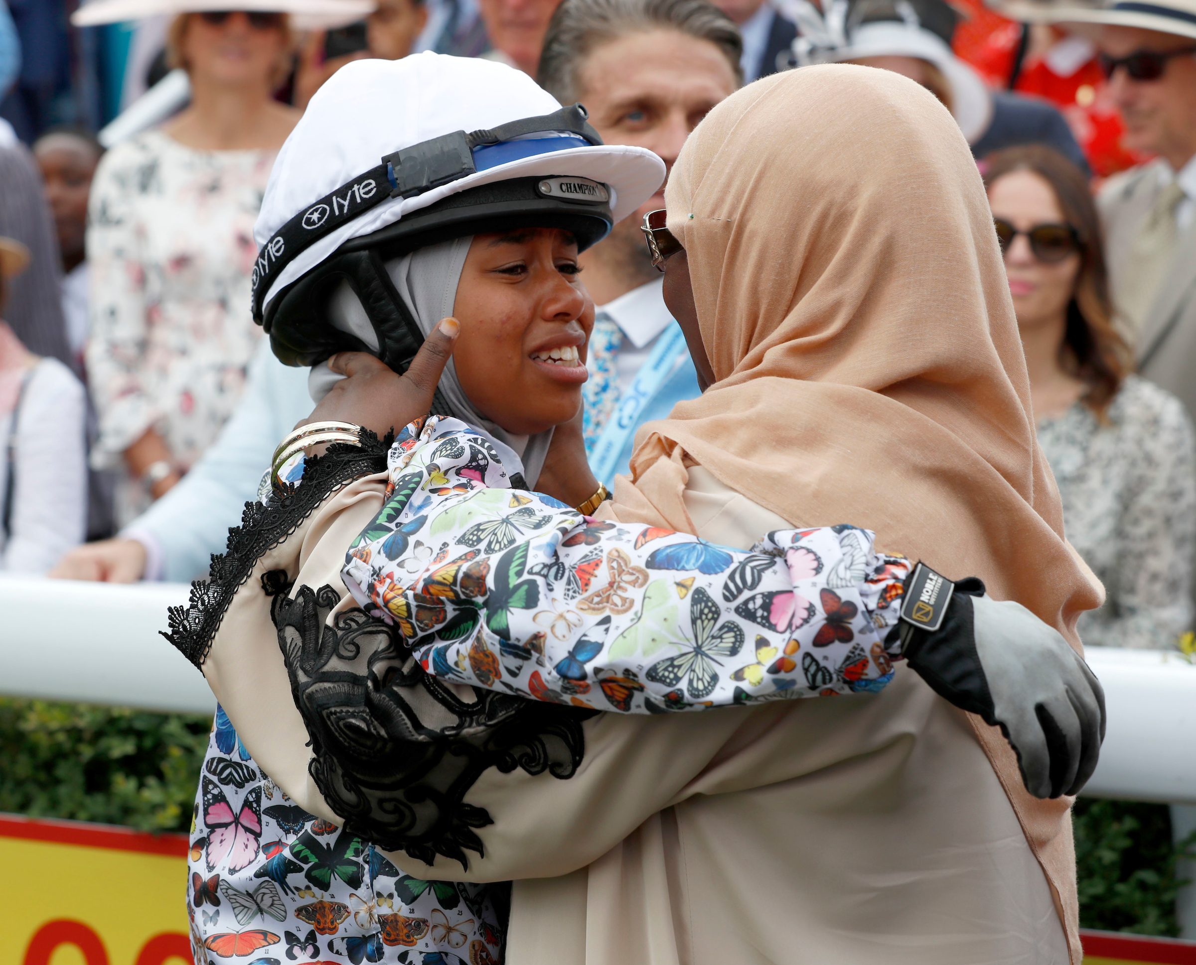 Teenager wins as she becomes first jockey to race in hijab