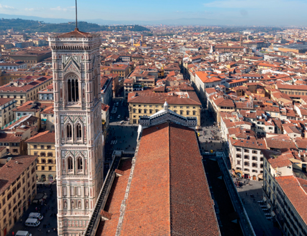 The Campanile and the body  of the Cathedral seen from the Dome,  projects which involved Arnolfo di Cambio,  Andrea Pisano, Giotto for the first part  of the Campanile, Francesco Talenti and others