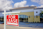 Vacant Retail Building with For Lease Real Estate Sign