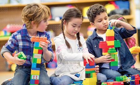 Young Kids Playing With Blocks