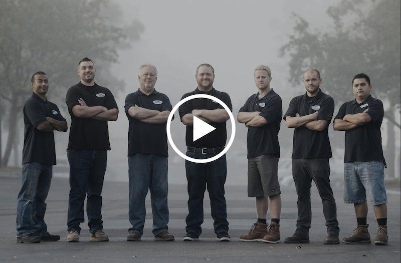 men-standing-video-play-thumb