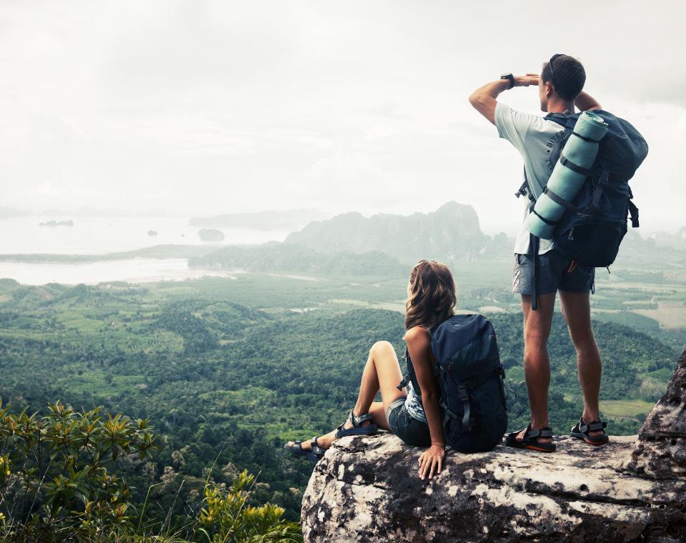 hiking-couple-taking-in-mountain-view-i-screen