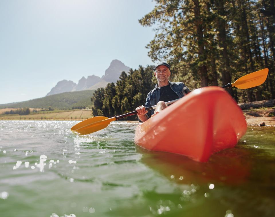 older-man-in-canoe-on-river-i-screen