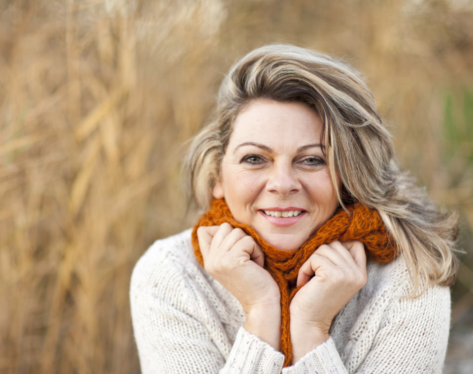 middle-aged-woman-hugging-her-scarf-i-screen