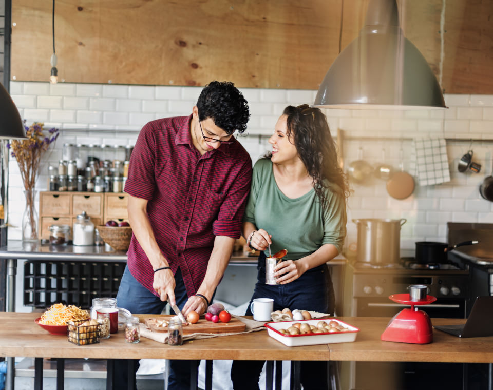 couple-laughing-while-they-prepare-a-meal-i-screen