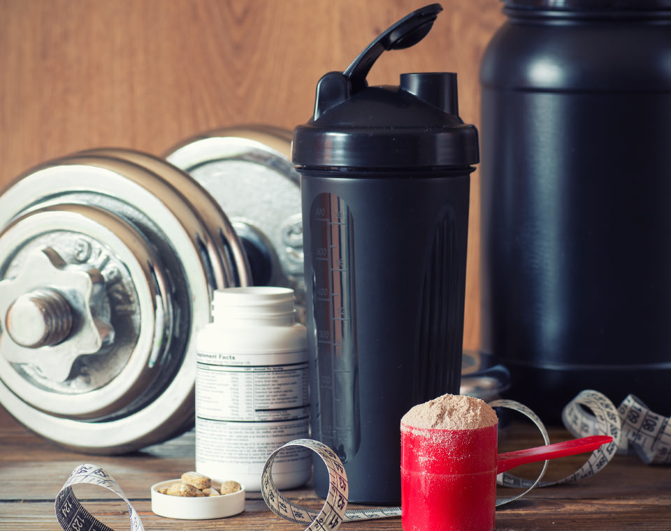 weights-tape-measure-and-supplements-on-table-healthily