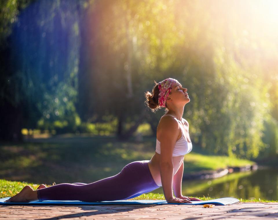 woman-doing-yoga-on-deck-i-screen