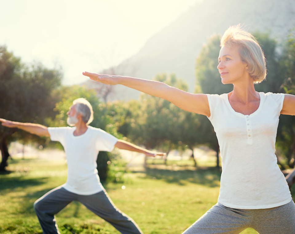 older-couple-doing-yoga-in-a-park-i-screen