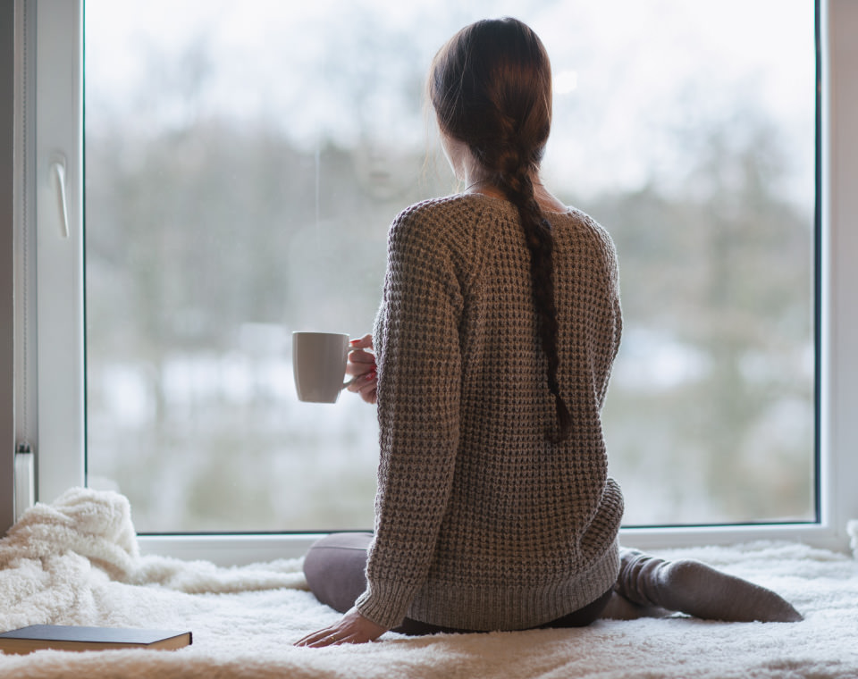 woman-drinking-coffee-looking-out-window-i-screen