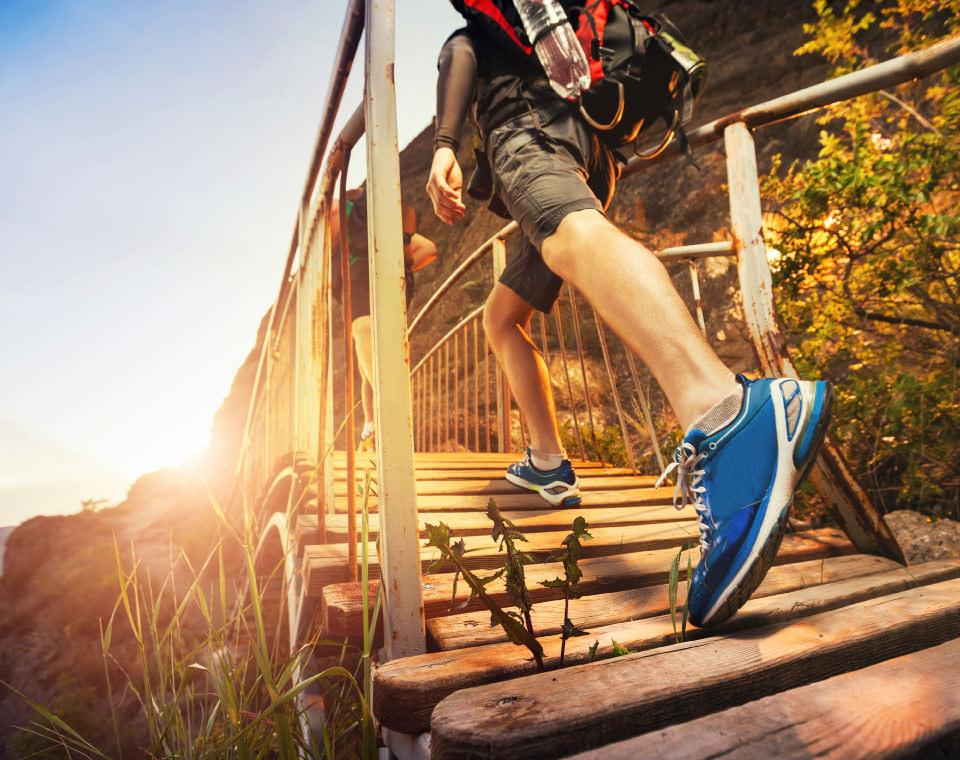 close-up-of-hiker-walking-up-wooden-steps-i-screen