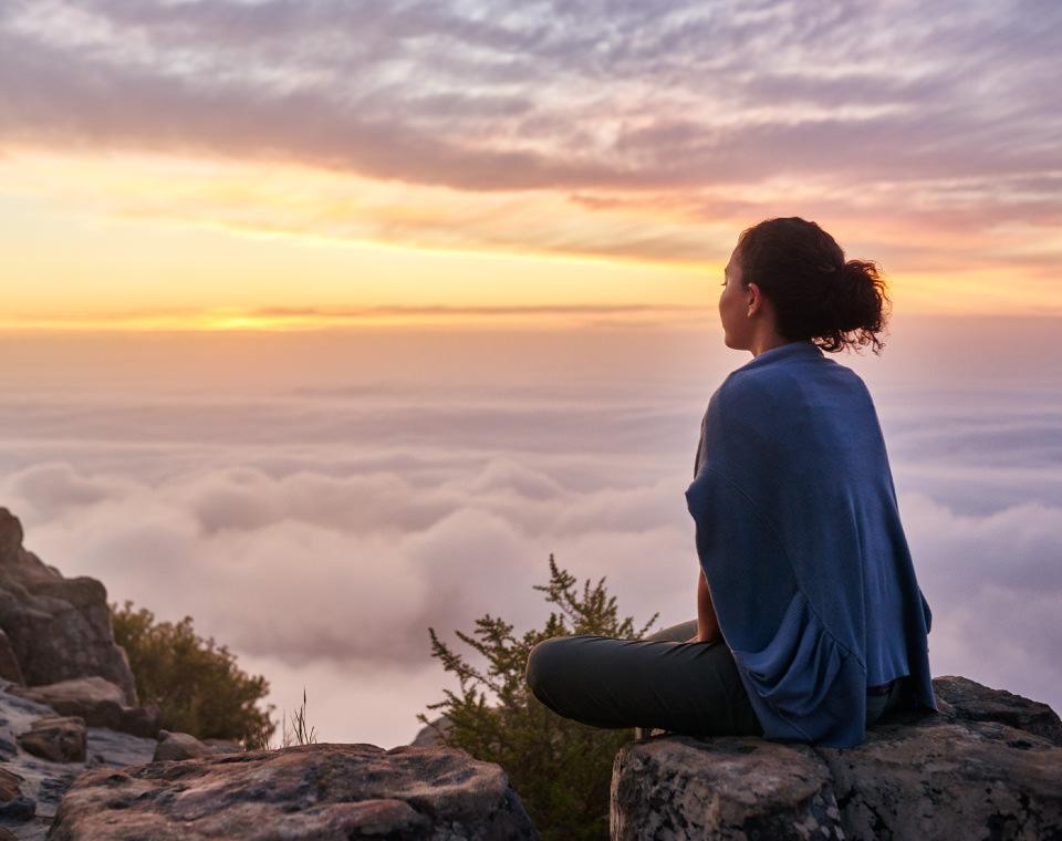 woman-sitting-on-mountain-soaking-in-twilight-i-screen