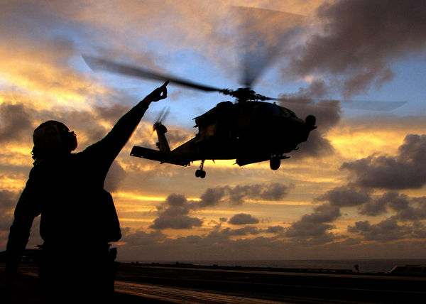 aviation-electricians-mate-airman-john-broughton-signals-to-an-hh-60h-seahawk-helicopter-as-it-takes-off l
