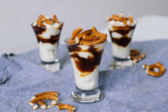 Caramel shots with pretzel topping