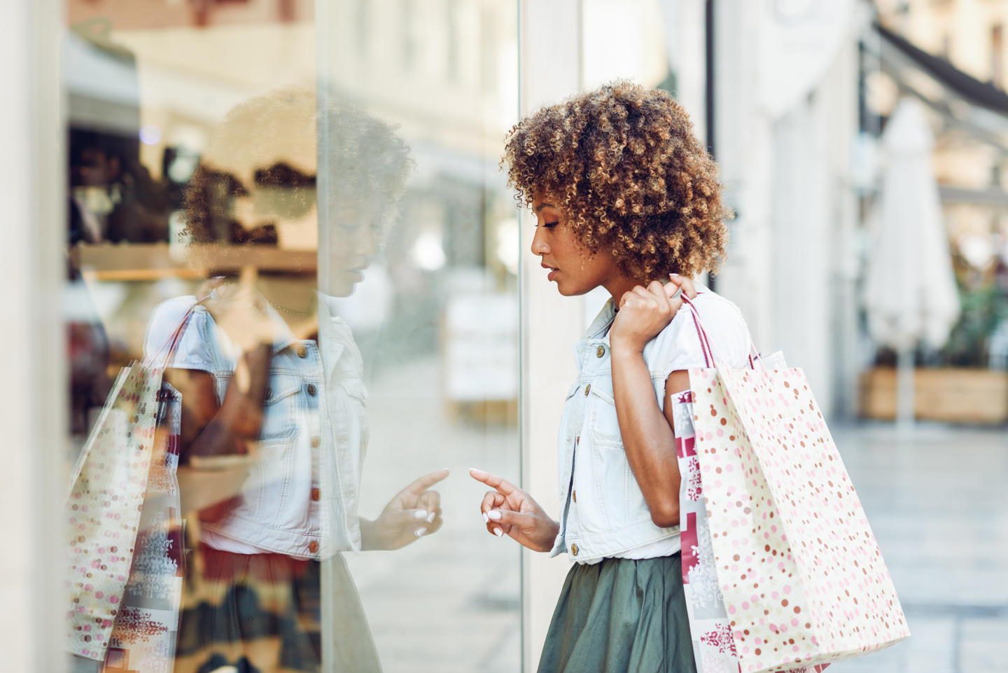 An image of a woman window shopping