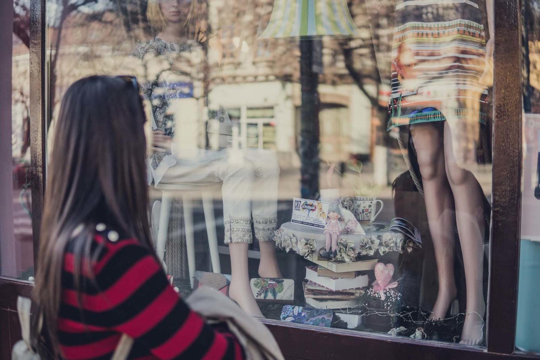 Woman standing outside store window
