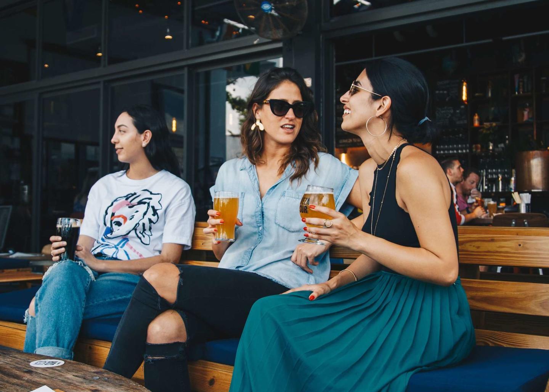 Three women holding drinks