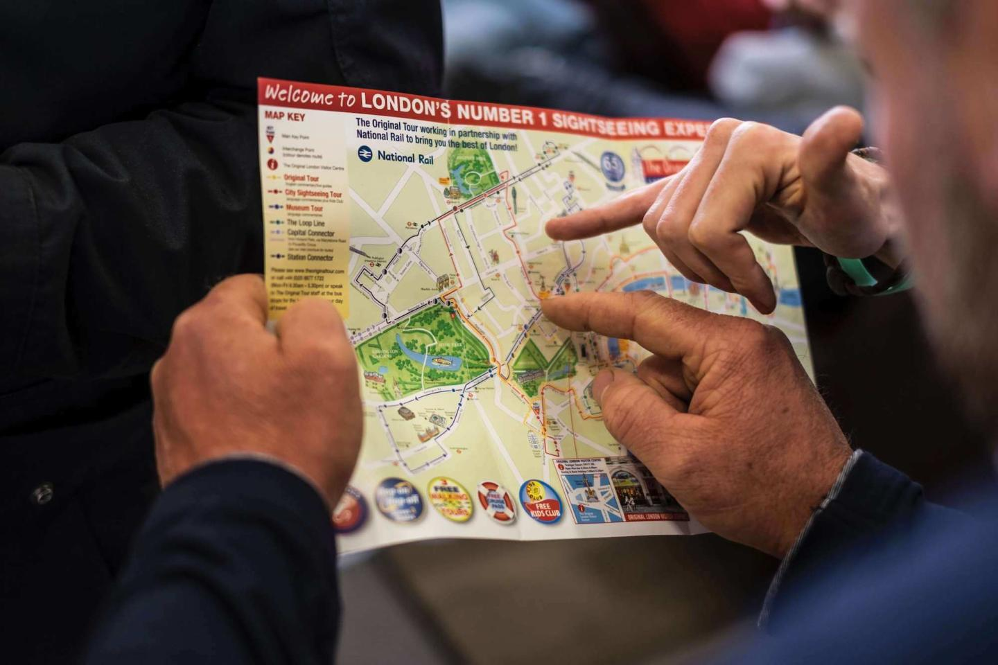 people reading a map of london