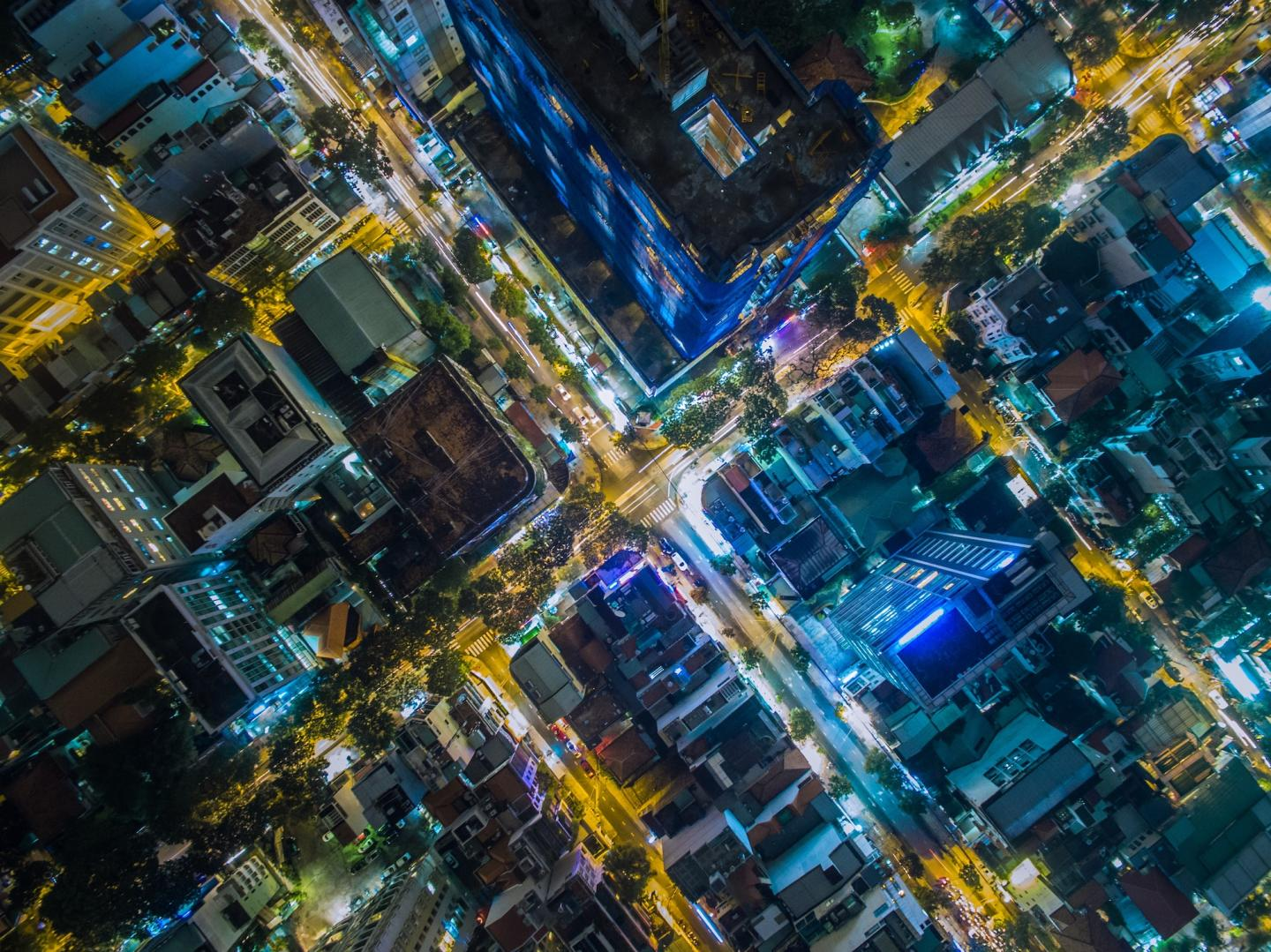 An aerial view of a city lit up at night