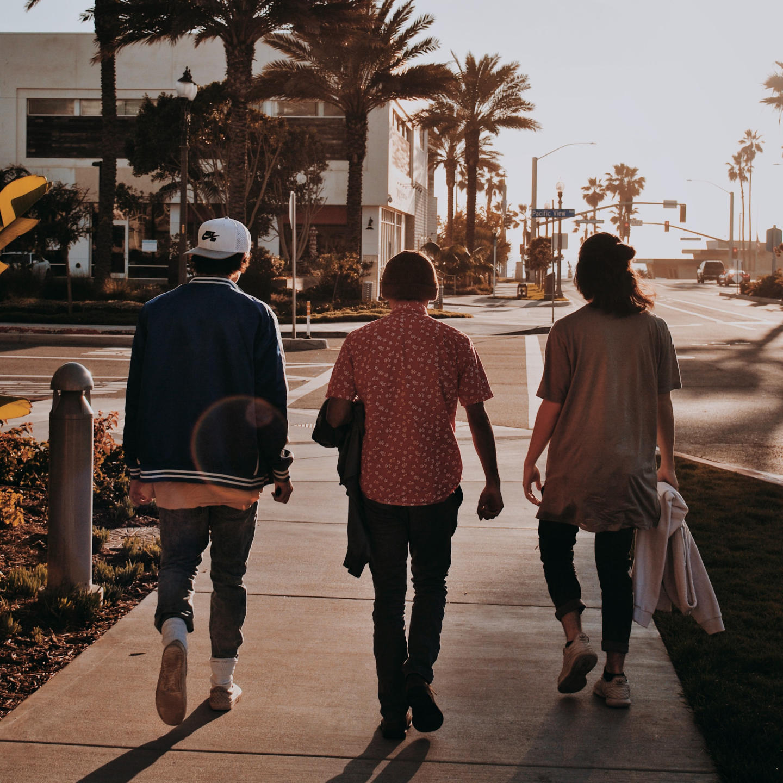 three men walking down the road