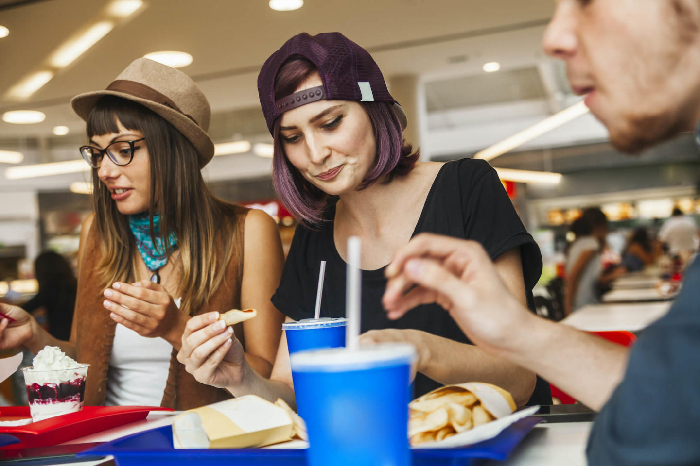 image of people eating at a foodcourt
