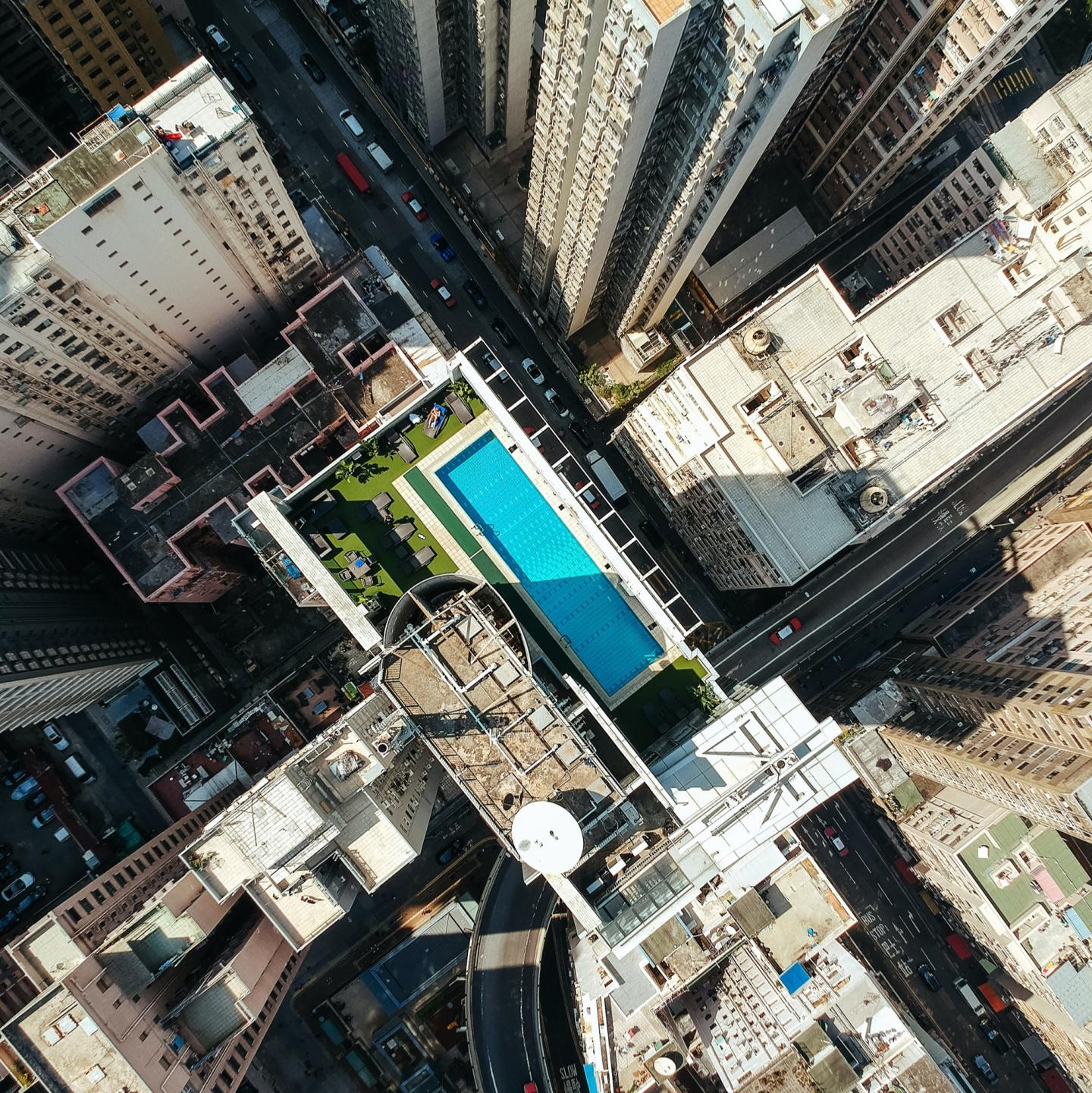 aerial shot of city and pool