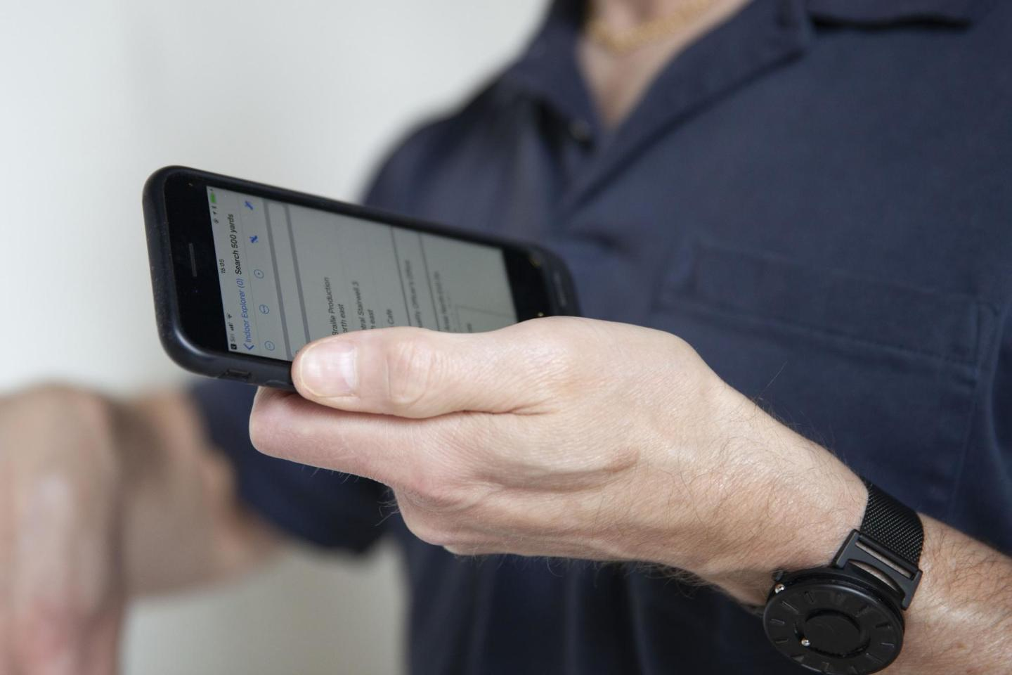 person holding cell phone
