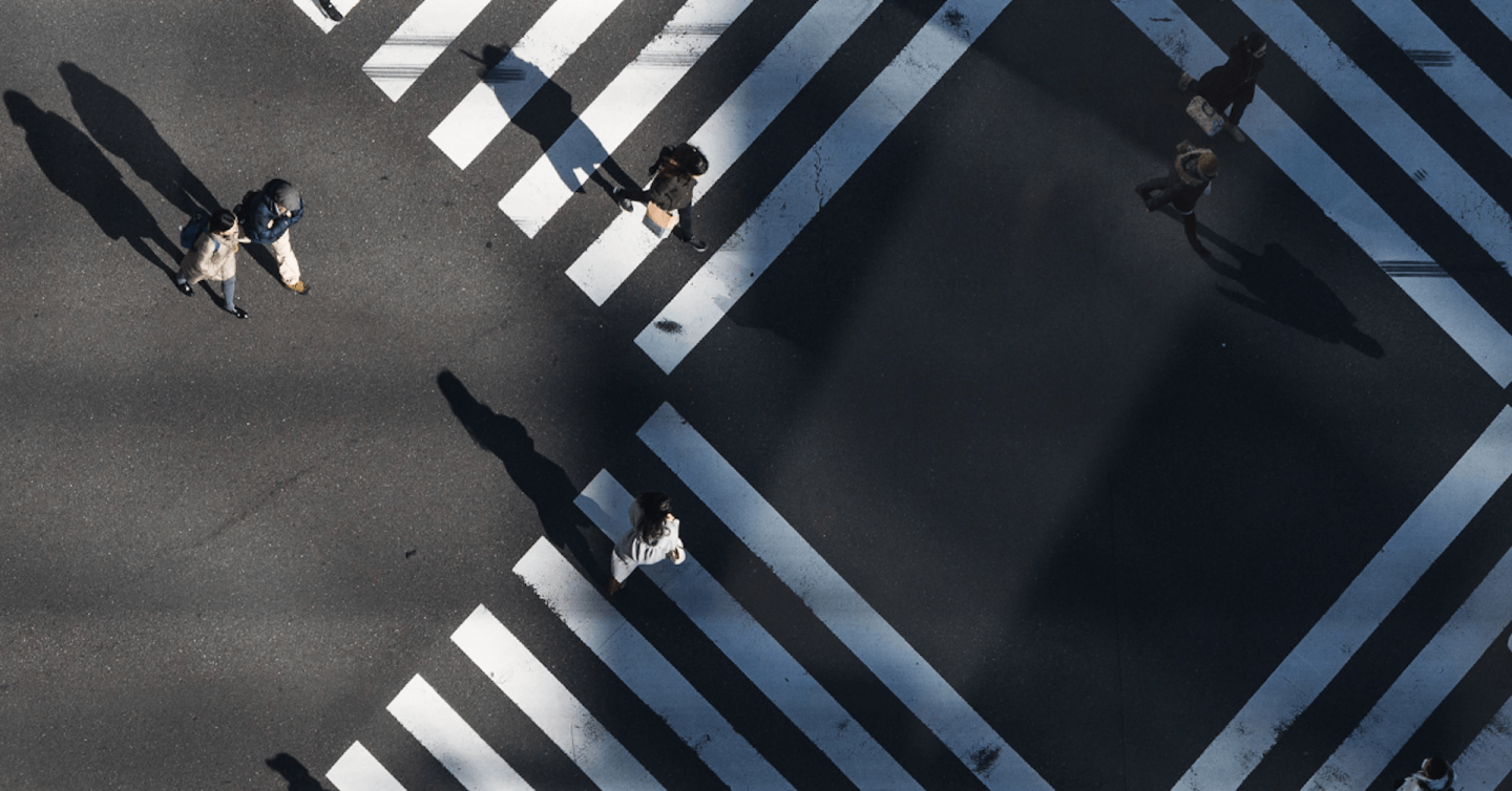 Above view of people crossing the street.