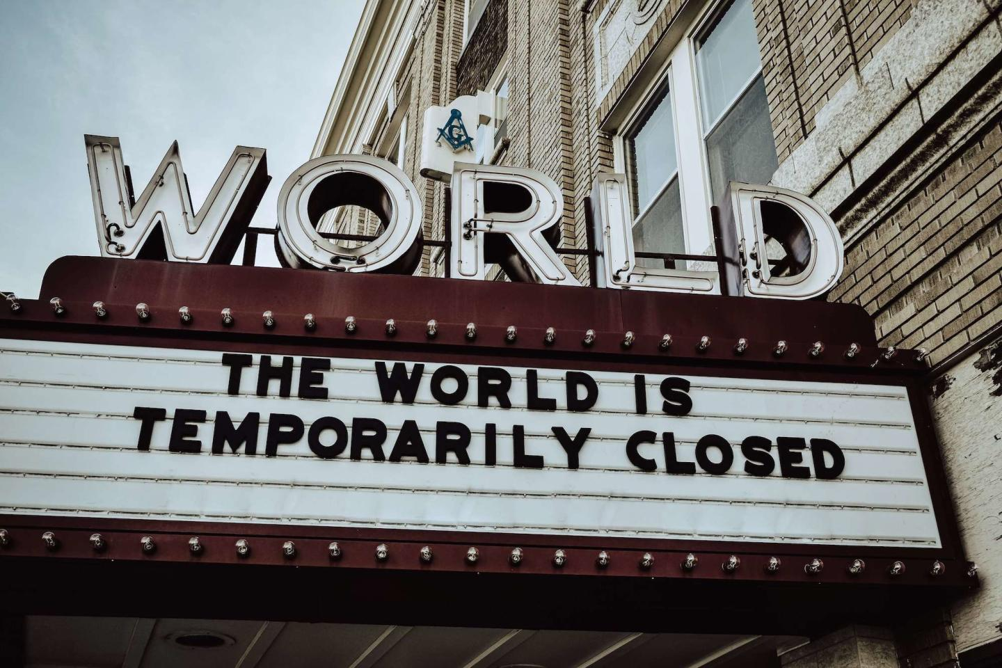 Movie marquee saying the world is temporarily closed