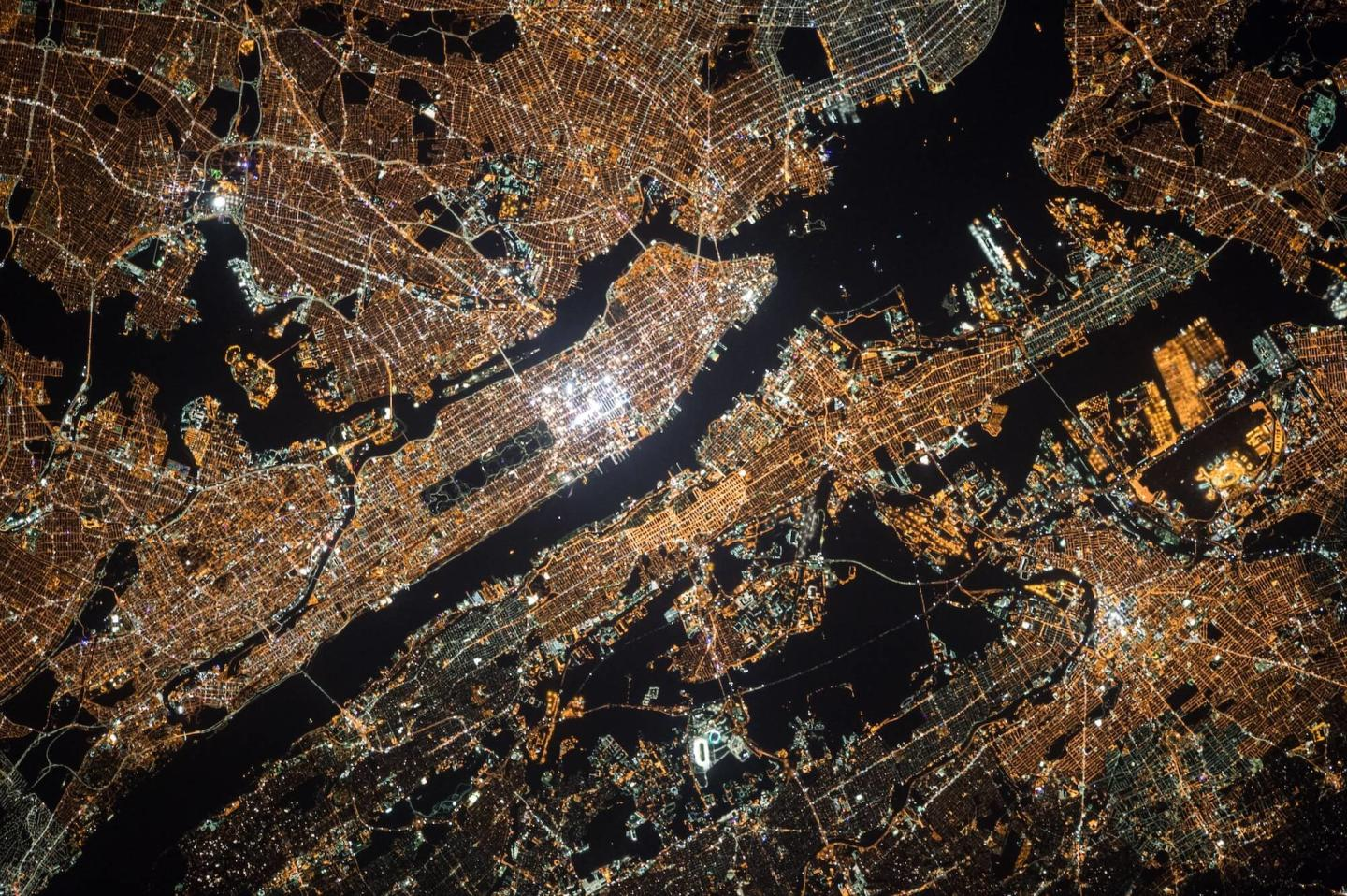 view of nyc at night with lights