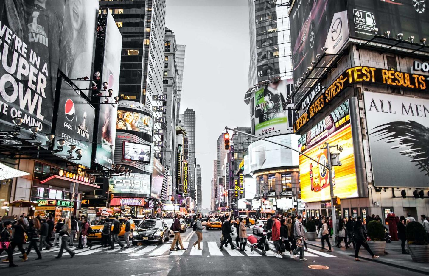 black and white background with advertisements in New York City in color