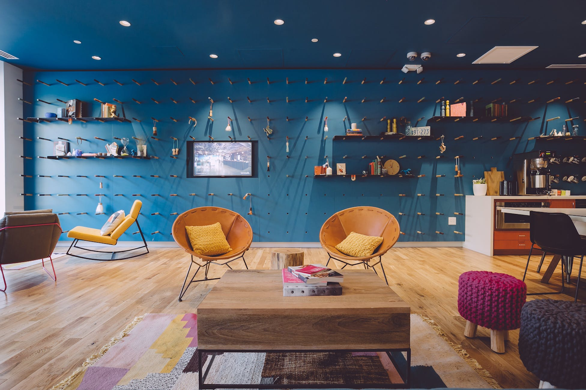 Common area with living chairs and square coffee table with magazines