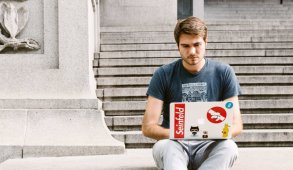 man learning on steps with seinfeld sticker