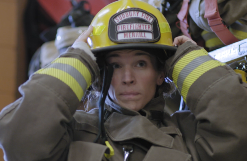 Woman in her firefighter uniform
