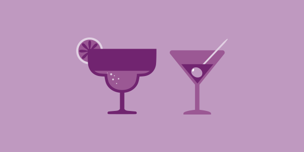 two glasses of alcohol one with lemon one with olive, two cocktails, purple