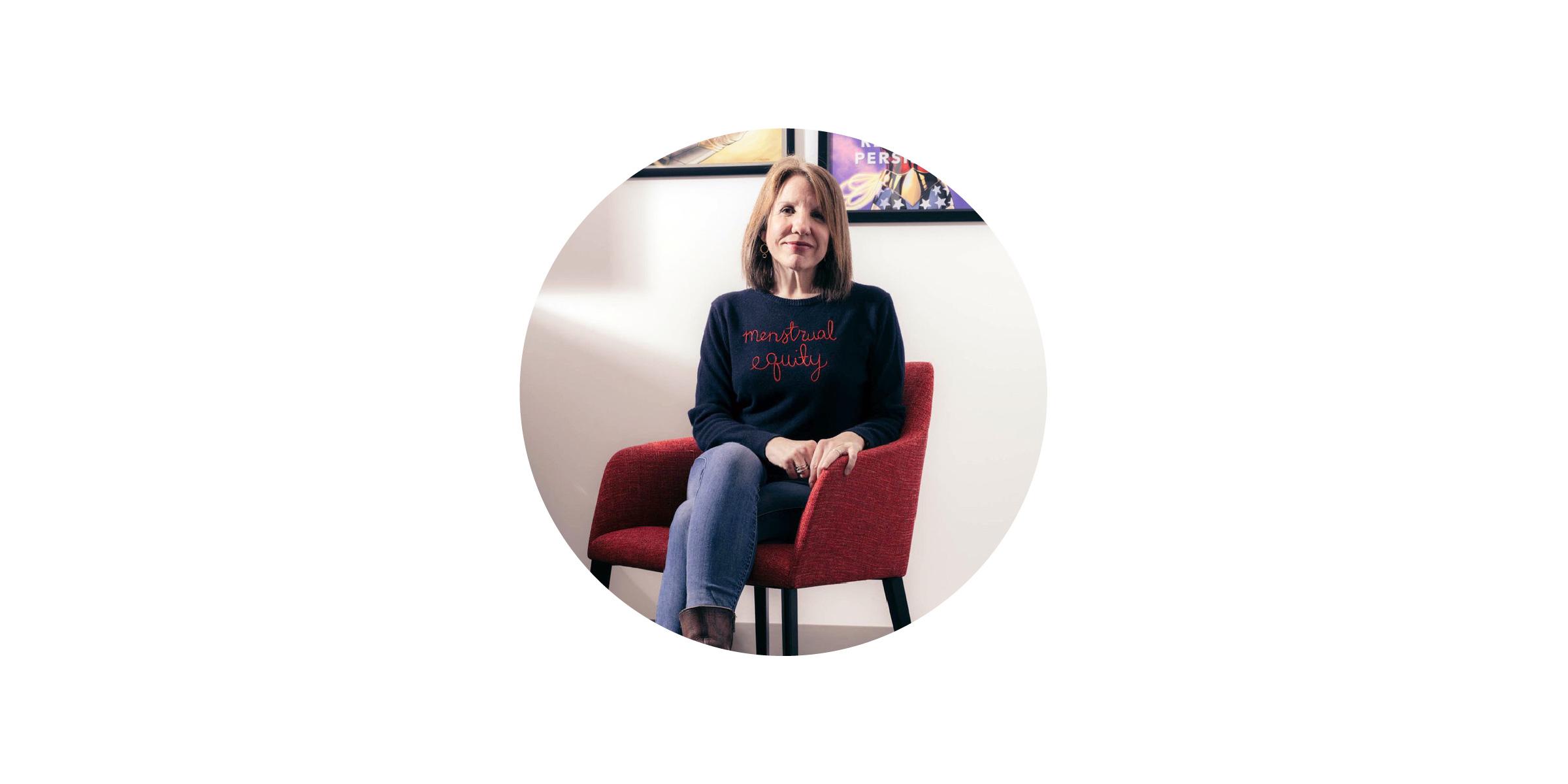 Photo of Jennifer Weiss Wolf, sitting on an armchair