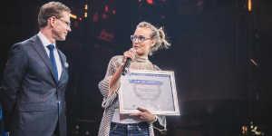 ida tin talking to the female web entrepreneur awards host on stage