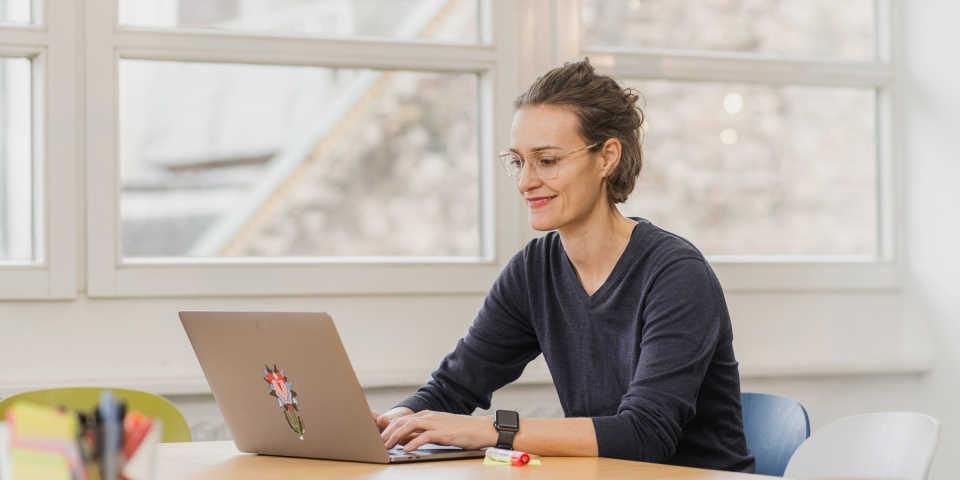 Ida Tin, CEO of Clue, using a computer