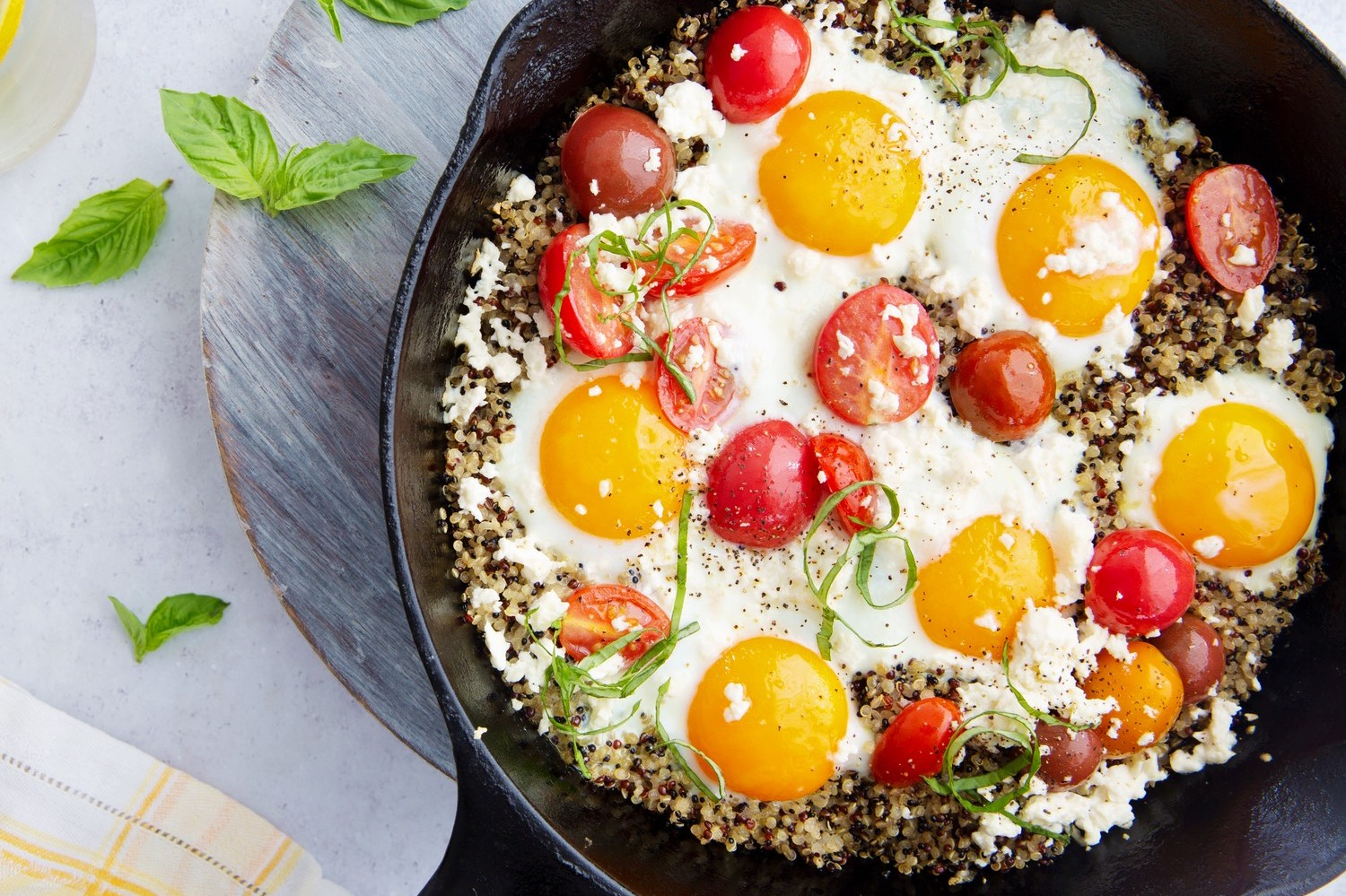 This summer skillet is filled with quinoa, heirloom tomatoes, basil, and feta cheese. Perfect as a summertime lunch or appetizer. | peteandgerrys.com
