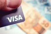 Man Holding Visa Credit Card