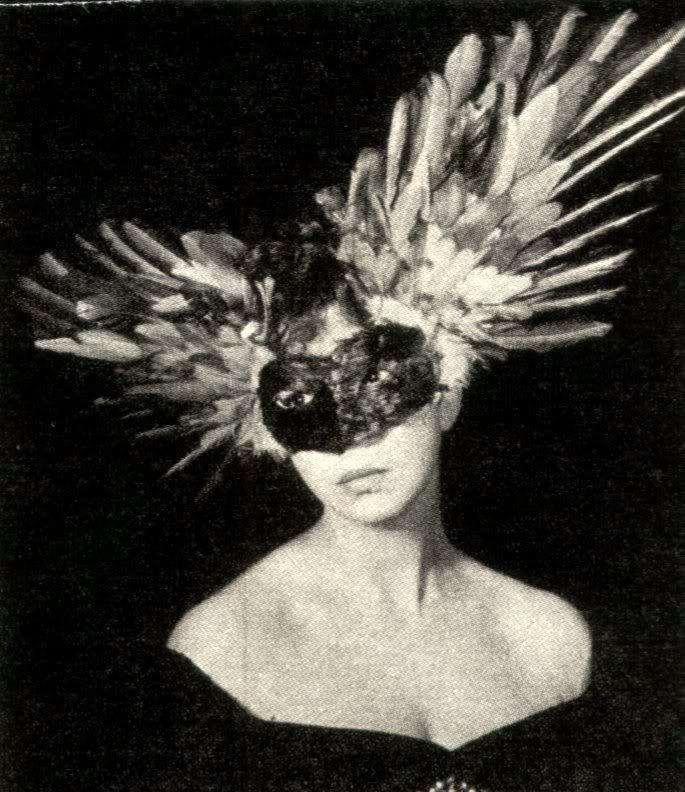 Leonor fini wearing a feathered mask  vogue  unknown photographer  1946