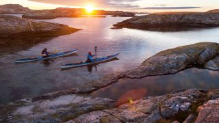 Two paddling in the Nordic evening sun