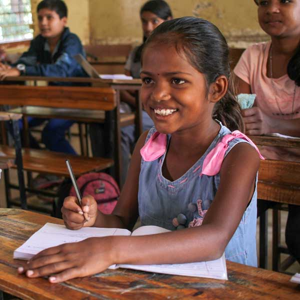 Female child writing in classroom