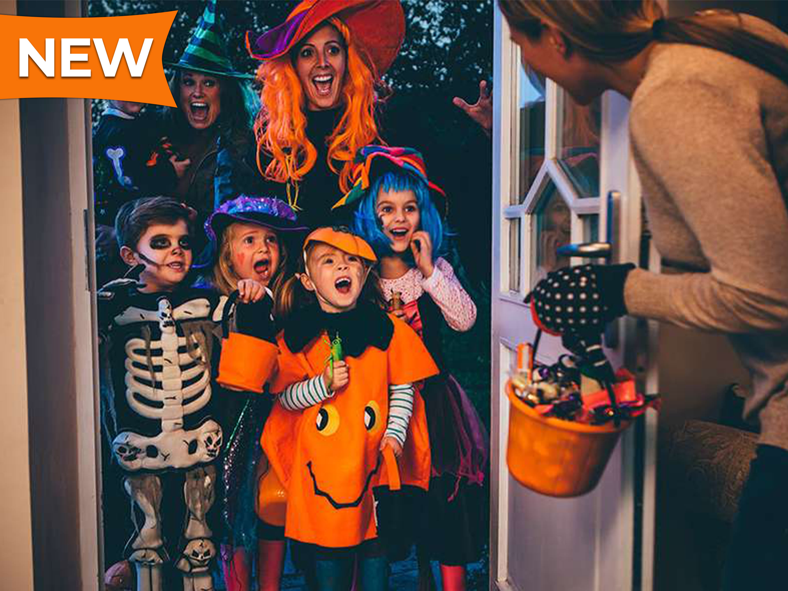 Children and their mothers in colorful costumes trick-or-treat on Halloween.