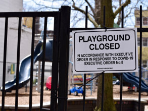 A Chicago Park District sign saying a playground is closed due to the Coronavirus pandemic in Chicago, April 2020.