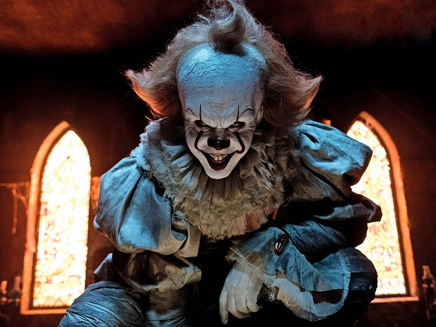 "Actor Bill Skarsg氓rd as Pennywise the Dancing Clown in the 2017 film adaptation of Stephen King's classic horror novel, ""IT."""