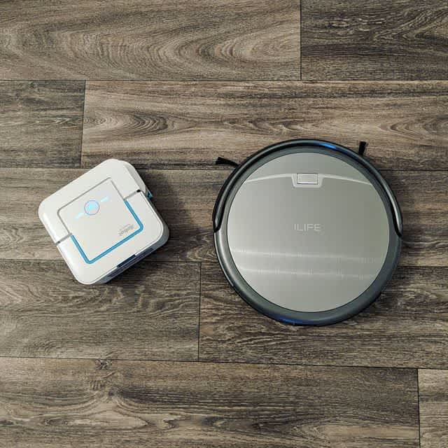 Overhead photo of iBraava jet robot mopper and ILIFE robot vacuum