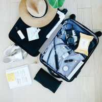 Flat lay of a packed vacation suitcase