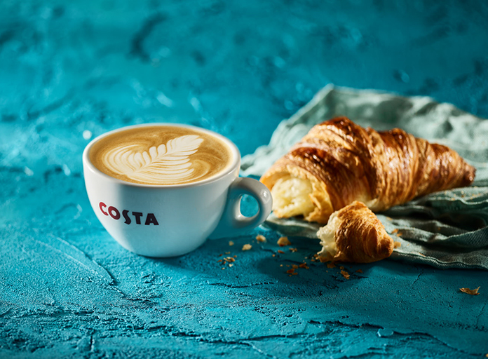 Costa coffee flat white with croissant